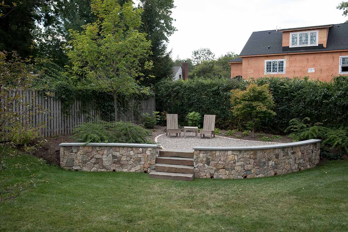 Raised Backyard Patio Made From Natural Stone